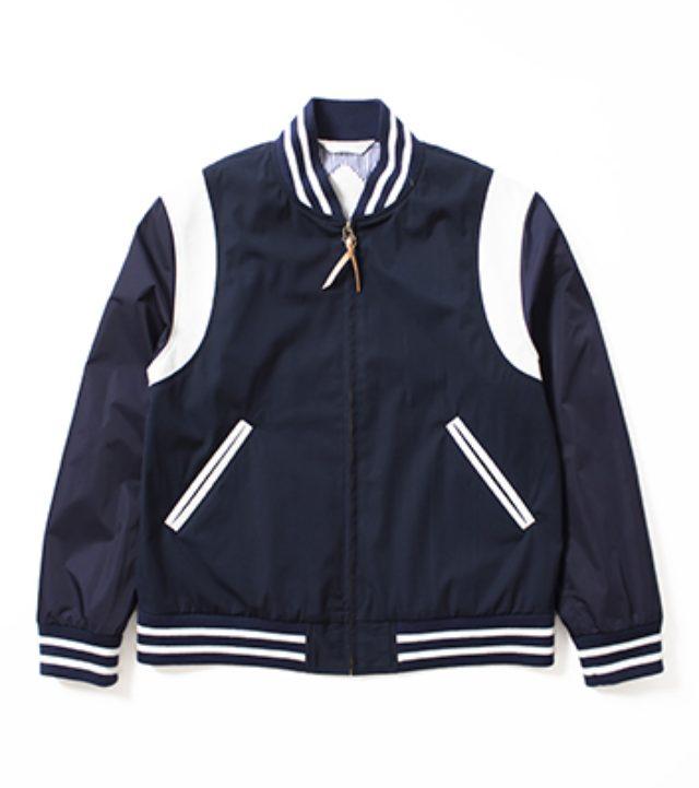 画像: nanamica 65/35 Varsity Jacket 65/35ベイヘッドクロスを使ったバーシティジャケット。袖はナイロンサテン生地で切り替え、肩やポケット玉縁部分はカウレザーを合わせました。裏地はCOOLMAX®のロンドンストライプ生地を使っています。ユニセックスサイズ展開です。 いま最高に欲しいスタジャン