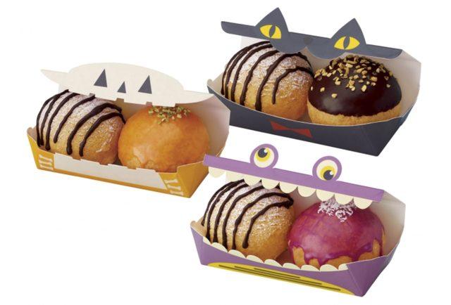 """画像: 旬の""""紫いも""""を使用したホイップを詰めた「ポン・デ・シュードーナツ 紫いも」、秋の定番""""パンプキン""""を使用したホイップを詰めた「ポン・デ・シュードーナツ パンプキン」、人気のカスタードホイップを詰めた「ポン・デ・シュードーナツ カスタード」と、ココアクッキー入りホイップを詰めた「ポン・デ・シュー クッキークリーム」の各2個をハロウィーン限定ミニボックスに詰め合わせました。"""