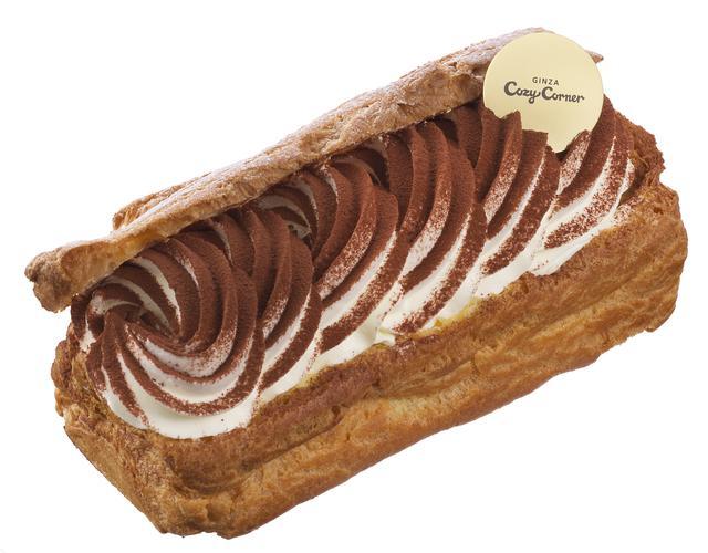 画像: 価 格: (約4人分) ¥1,050(税込¥1,134) 販売期間: 2017年2月1日~4月6日頃 特 長: 大きめに焼き上げたシュー皮の中には、カスタードとコーヒーが香るココアスポンジ、チーズクリーム。仕上げにココアパウダーをふりかけた、ほんのりビターなシュークリーム仕立てのティラミスです。