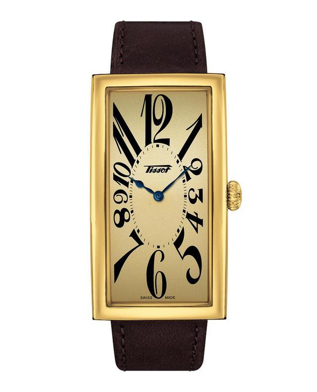 """画像: ティソ ヘリテージ バナナ センテナリー エディション 100周年の歴史を刻む伝説の時計、バナナ・ウォッチ。この呼称の由来となった手首に沿ってカーブするユニークなケースの形状に、文字盤にはデフォルメされた数字が伸びる大胆なデザインは、いくつものトレンドを乗り越え、時代を超越しています。100周年の節目の年を経て、さらに魅力に磨きをかけた新作モデルは、クラシックロゴに、カレンダーや秒針さえも省いたドレッシーなスタイルを再現し、美しい曲線を纏ったスペード針とインデックスがアール・ヌーヴォー当時の優雅な時を刻みます。モデルにより、異なる表情をもつバナナ・ウォッチは、クールからエレガントまで、装いにアクセントを加えるアイテムです。ファッションや気分に合わせて、他のカラーバリエーションも欲しくなるバナナ・ウォッチは身近な方とシェアして楽しむ""""シェアウォッチ""""としてもお勧めです。 www.tissotwatches.com"""