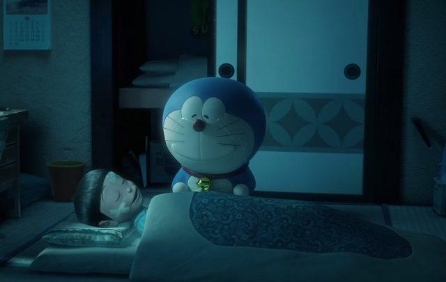 画像: 眠りにつくのび太を、嬉し涙を浮かべながら見つめるドラえもん doraemon-3d.com