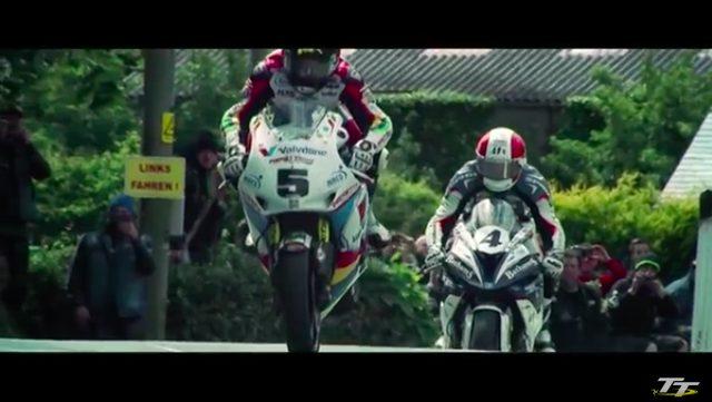 画像: 公道を利用したTTコースには、幾つかのジャンピングスポットが存在します。ゼッケン5は昨年度のスーパーバイククラスを制覇したB.アンスティ(ホンダ)ですね。 www.youtube.com