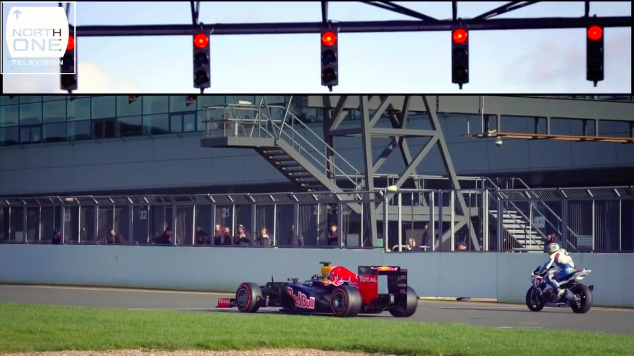画像: グリッドに着くレッドブルF1と、BMWスーパーバイク・・・スタートの時を待ちます・・・。 www.youtube.com