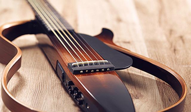 画像: サイレントギターTM / SLG シリーズ 自宅でも、旅先でも、スタジオでも、ステージでも。演奏する場所や場面に関わらず、ギタリストの気持ちに寄り添う、静粛性と高音質を両立したギター。 global.yamaha-motor.com