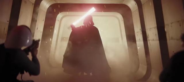 画像: 黒い巨大なシルエット。ゆっくりとライトセーバーを抜きます。