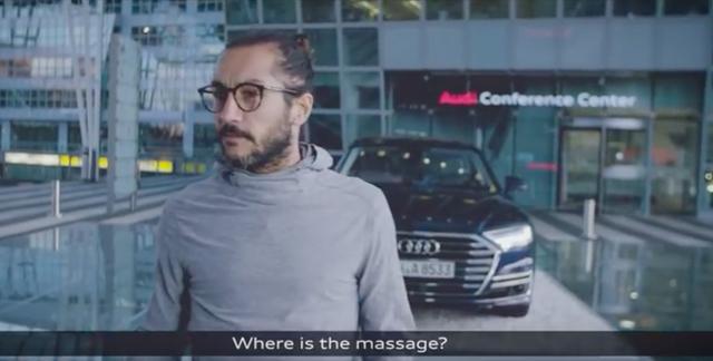 画像: 案内された先にはAudi A8が。「マッサージはどこ??」と訝しがる男性。 youtu.be