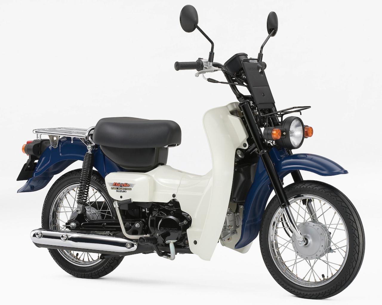 画像: S051 SUZUKI BIRDIE50/セル/新聞 ■価格:21万600円/22万1400円/22万7880円 アンダーボーン構造による低重心の車体が業務用途での使い勝手が良好なビジネスバイクのバーディ。エンジンは粘り強く扱いやすく、低燃費で信頼性が高い点でも評価されている。