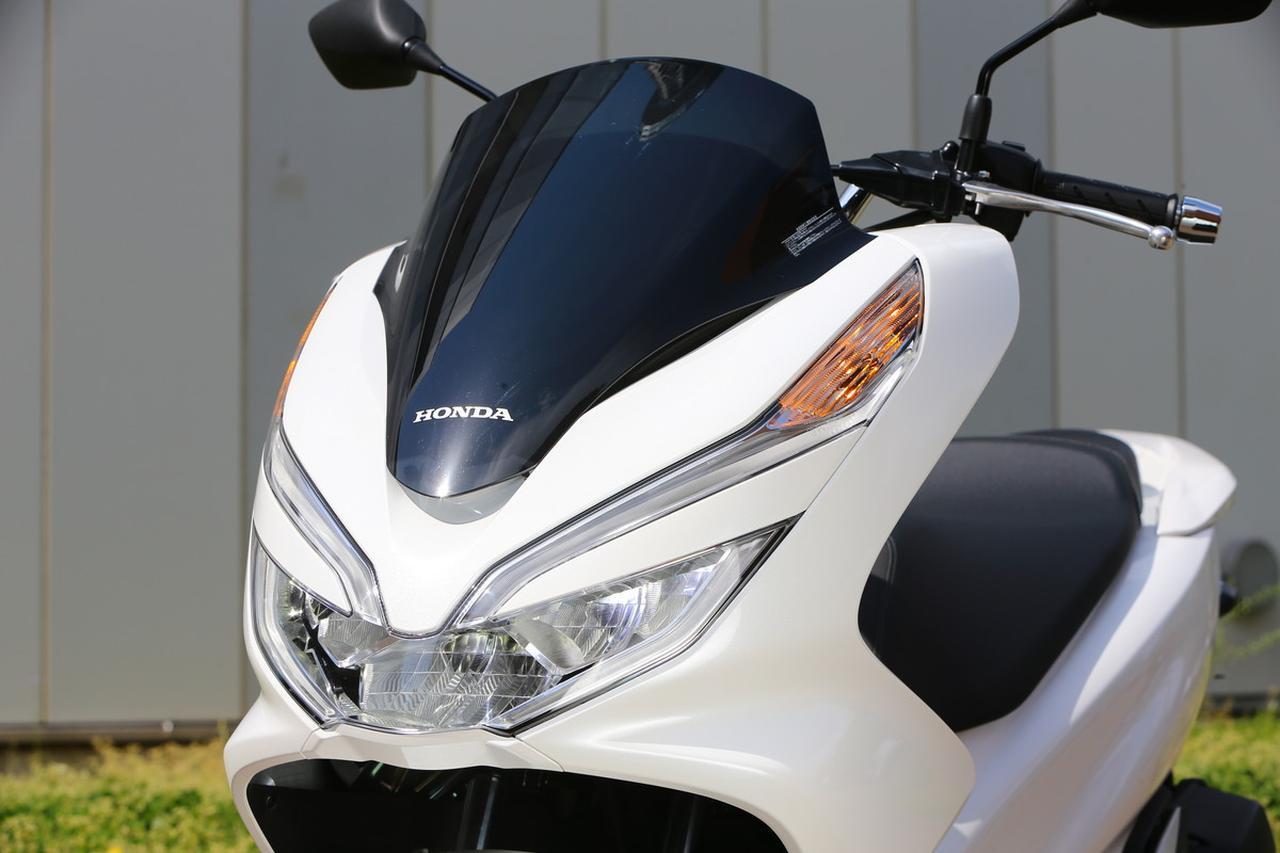 画像: 大型コンビネーションランプは、ヘッドライトとポジションライトの間に ボディカバーが入り込む造形を採用してシャープなイメージを表現。