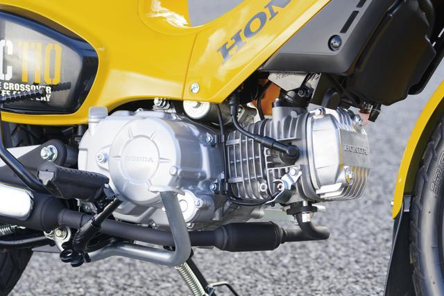 画像: 排気量109㏄の空冷単気筒エンジンは8PSを発揮。クランクケース下に交換式カートリッジオイルフィルターが見える。