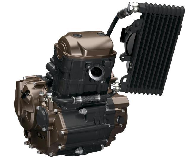 画像: 注目の油冷エンジンは26PSを発揮。高効率でユニークな冷却システムにより、冷却フィンを不要とし、大幅なコンパクト化を達成している。