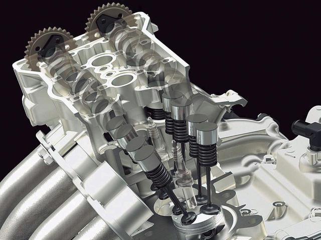 画像: 精密な構造のバルブ回り。カムシャフトの駆動方式はサイドカムチェーン。カワサキの高性能エンジンが代々採用してきた方式だ。