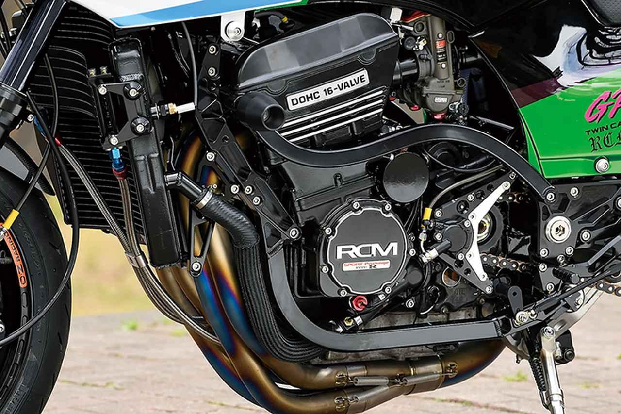 画像: エンジンはA12のノーマル状態で、ヘッドバイパスはTGナカガワTYPE2に。キャブレターはTMRφ38mm-MJNのデュアルスタック・ファンネル仕様+アクティブ・ハイスロットル。冷却系もナイトロレーシング・ワイドラジエーター+ハイマウントオイルクーラーをチョイスした。