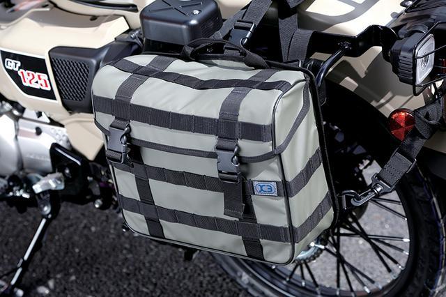 画像: 新たにスタートしたアウトドア系ブランド「K3」ネームで開発中のサイドバッグ。別売りのバッグサポートを装着後、ストラップで取り付ける。汎用で他車種にも使用可能。