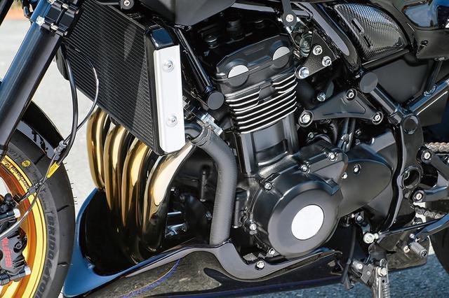 画像: エンジン下側にはサーキット走行に合わせてアンダーカウル(A-TECH製で、これもボディカラーに合わせてペイントされる)を追加して機能とスポーティなイメージを両立している。