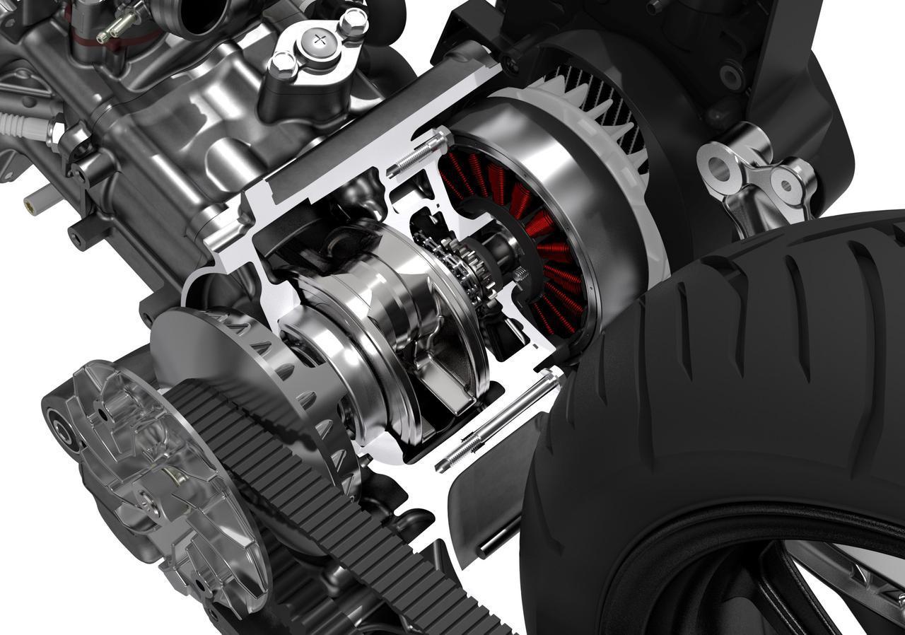画像: ユニットスイング式の4ストローク単気筒124ccエンジンの、クランクシャフト右側につくACGスターター兼アシストモーター。ACGにアシストさせることで、従来のICEV並みにコンパクトな機関寸法を具現化しています。 www.honda.co.jp