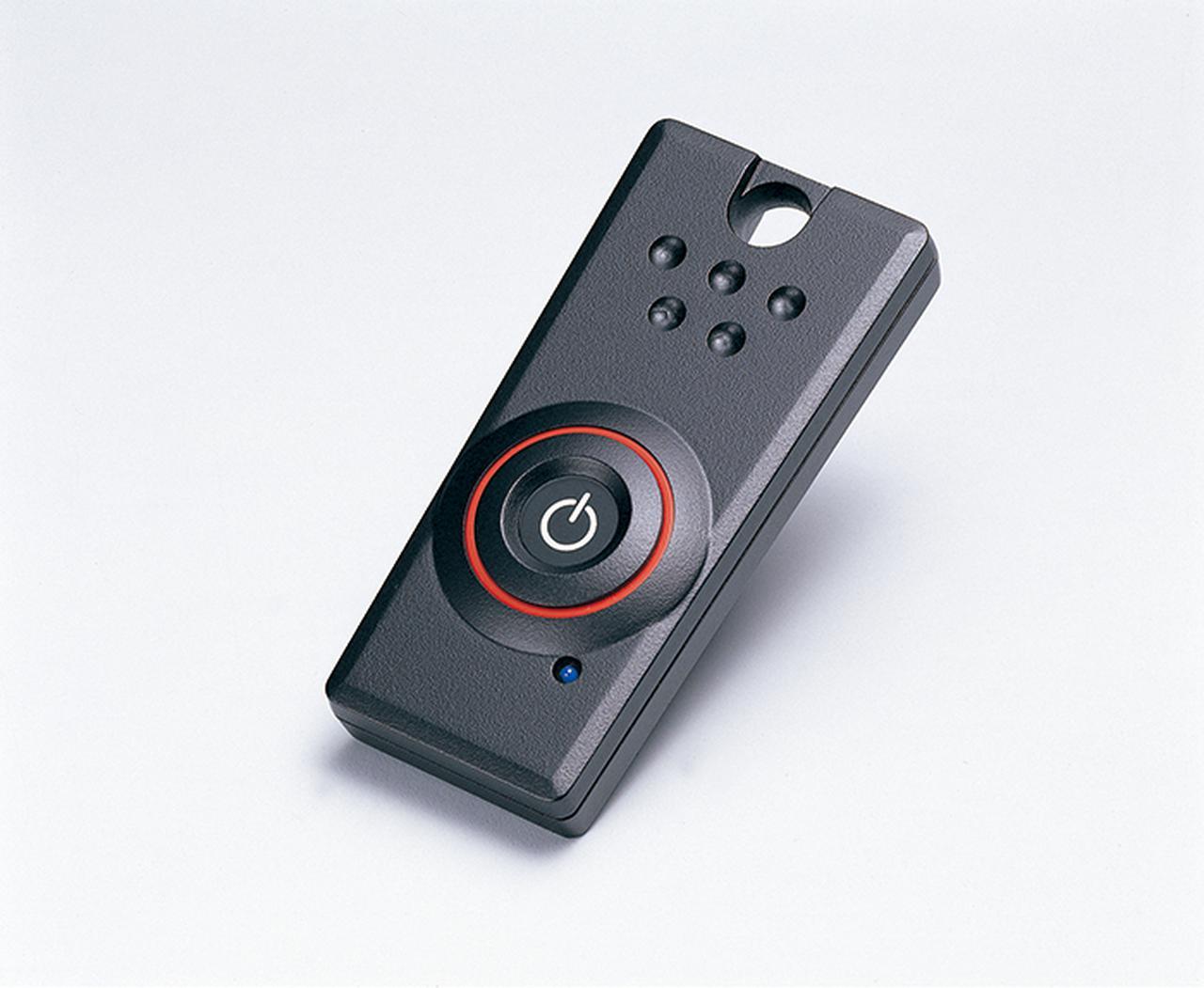 画像: ▲2004年当時「Hondaスマート カード キーシステム」のスマートキー。