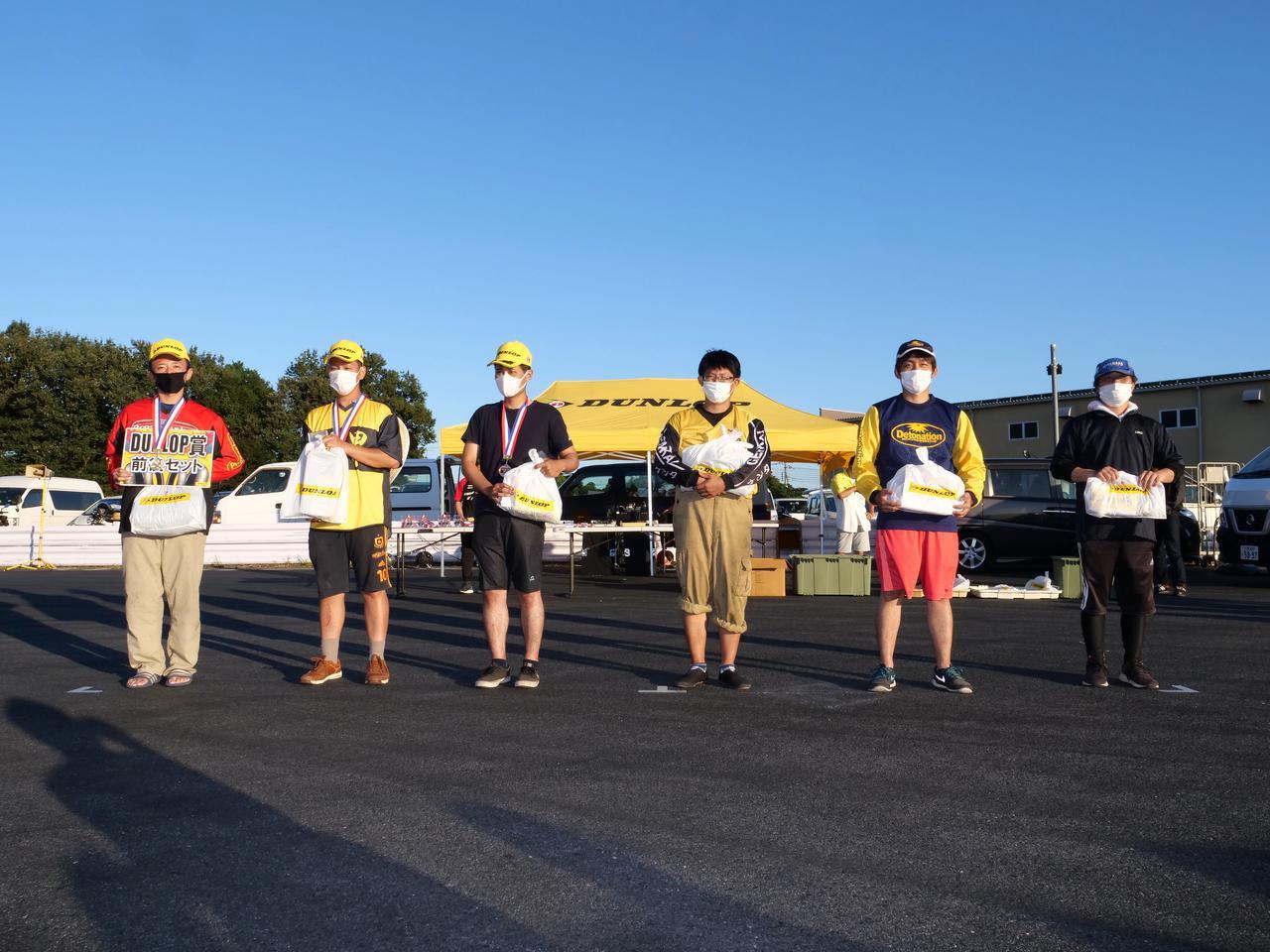 画像: ●B級入賞者 左から1位・関根 健選手、2位・濱田 令選手、3位・江口 柊選手、4位・木村健太選手、5位・柳田豪悦選手、6位・井川洋一選手 各クラスのウイナーには、ダンロップ賞としてダンロップタイヤ前後1セットが贈られる。