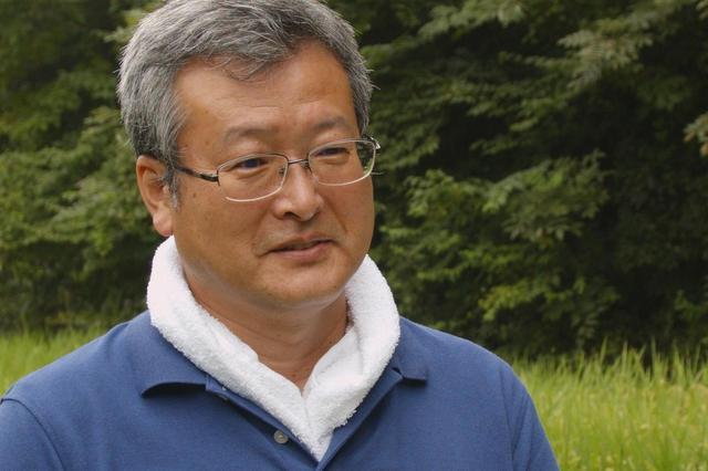 画像: 日立製作所 環境推進本部 本部長 ITエコ実験村 村長 出居昭男