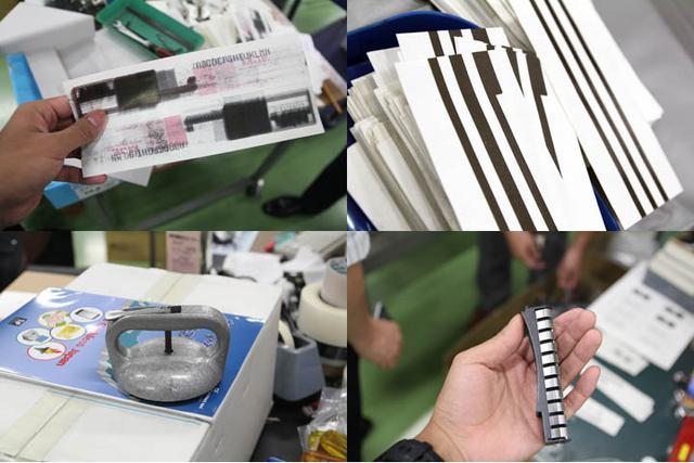 画像: 試し刷りの紙や、重い荷物に吸着させて持ち上げるハンドル、虫に見えなくもない緩衝材