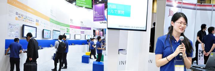 画像: 天板を壁に収容しすっきりしたブース(左)。中央の一回り大きいモニターが新しく出展したCiscoSpark。遠隔のオフィスとつなげ、1台で電子黒板やWeb会議を駆使したようなコミュニケーションができて便利。右はその紹介の様子。