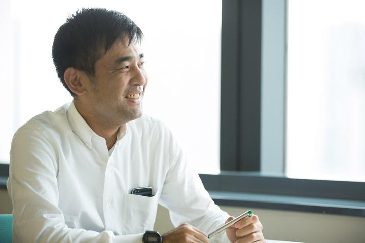 画像: 金融のお客さまを担当する営業部長。他のモデルを撮影中に予定なく撮影。