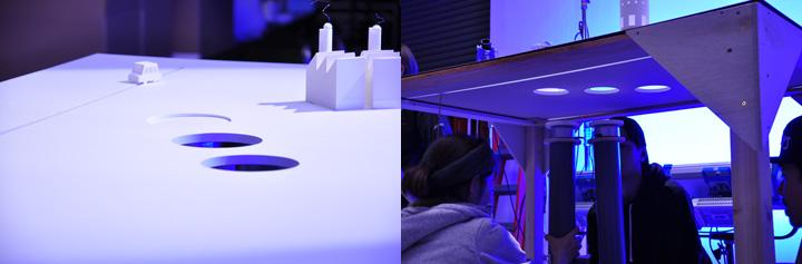 画像: 工場が地面から回りながら出てくるシーンは、ターンテーブルを先端に取り付けた円柱(パイプ)を、スタッフさんが手で押し上げる方式。調整にはかなり手間取った。