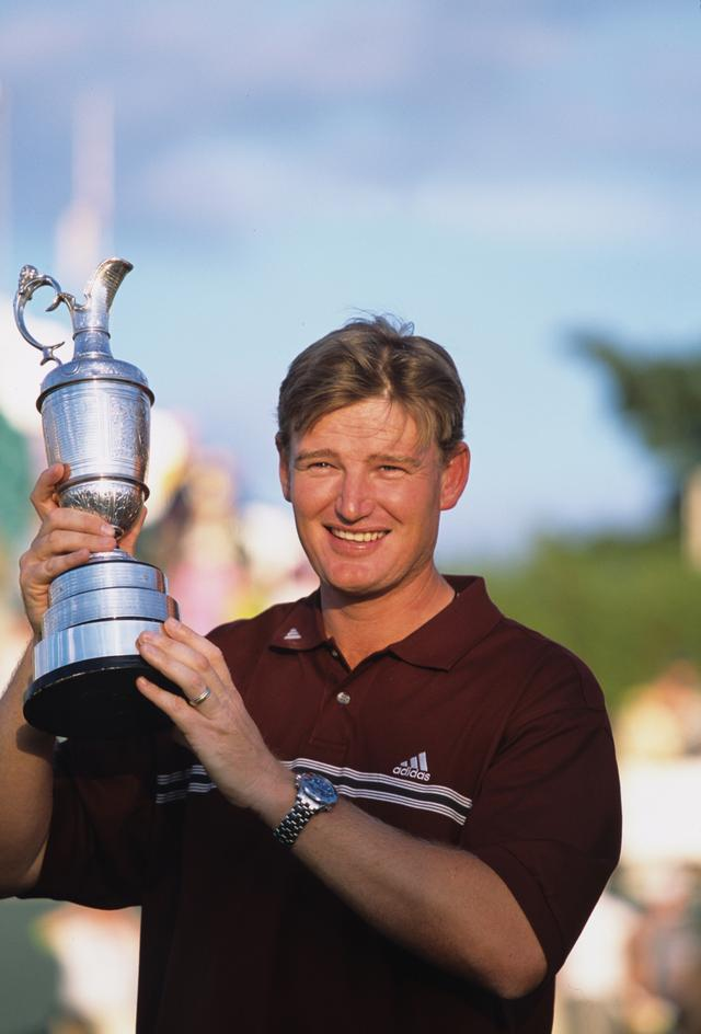画像: '02年、全英オープンで初優勝を飾り、クラレットジャグをもつアーニー・エルス