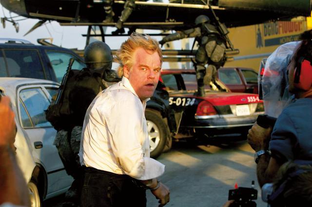 画像: デイヴィアン(フィリップ・シーモア・ホフマン) 敵。人の心を壊す術に長けている冷酷な武器商人