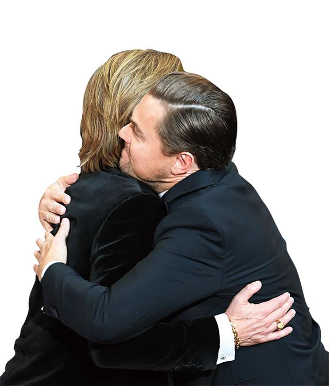 画像: 助演男優賞アナウンスの時、共演者レオナルド・ディカプリオと思わず抱き合うブラッド