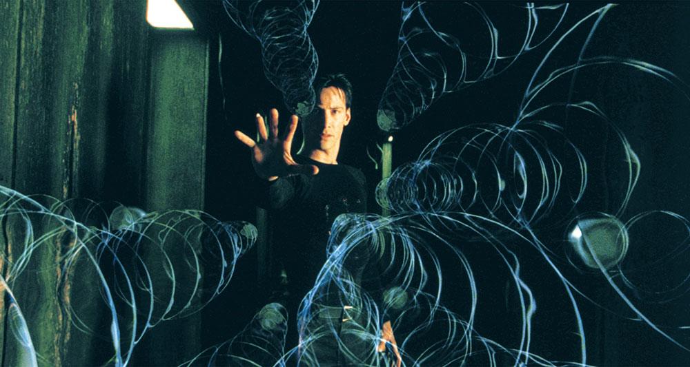 画像: 流れ落ちる緑のコンピュータコード 「マトリックス」(1999)
