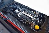 画像: 1L直3自然吸気エンジンをリアに搭載して後輪を駆動する。JC08モード燃費は21.9km/Lとなる。