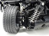 画像: ▲サスペンションは接地性にすぐれた4輪ダブルウィッシュボーン。Mシャーシ60Dラジアルタイヤを標準装備。