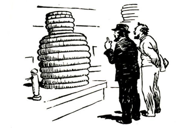 画像: タイヤの山を見て「タイヤ人間」を想像するミシュラン兄弟。 (C)Michelin