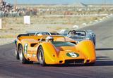 画像: 1960年代後半から70年代初頭にかけて、CanーAmレースを席巻したマクラーレンのマシンは、オレンジ色のカラーリングだった。