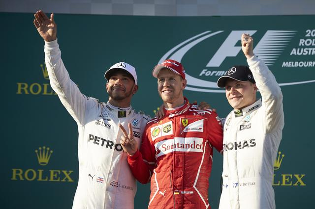 画像: 左から2位のルイス・ハミルトン(メルセデスAMG)、優勝したセバスチャン・ヴェッテル(フェラーリ)、3位バルテリ・ボッタス(メルセデスAMG)。