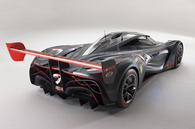 画像: 排気口にはロータリーの「おむすび」が。ルーフの模様やボディサイドの形状などはスーパーカーのよう。