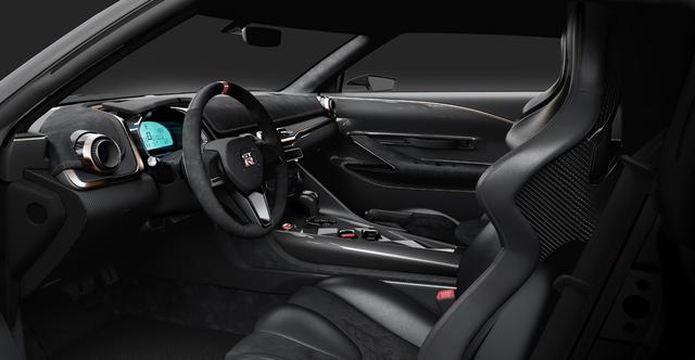 画像: ベース車のデザインを踏襲しながらも、メーターまわりなどを大胆にモデファイ。ステアリングもカーボン製に。