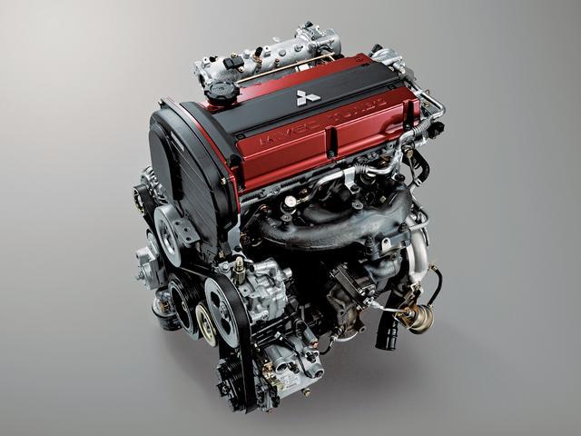 画像: MIVECを最適化させ、レスポンスを向上させたランエボⅨ MRのエンジン。チタンアルミ合金製タービンホイールとマグネシウム合金製コンプレッサーホイールを組み合わせた。