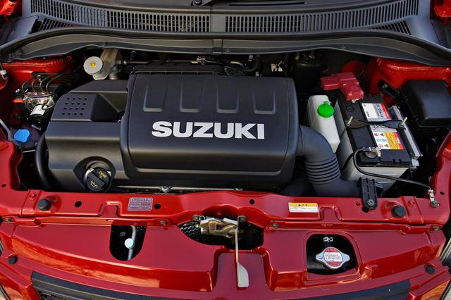 画像: ヘッドカバーに誇らしく「SUZUKI」のロゴが入れられた1.6LのDOHCエンジン。