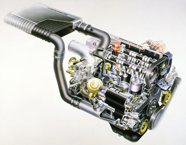 画像: MR2に搭載されたスーパーチャージャー付4A-GZE。エンジンをリアに積むため、インタークーラーをエンジン横に配置した。