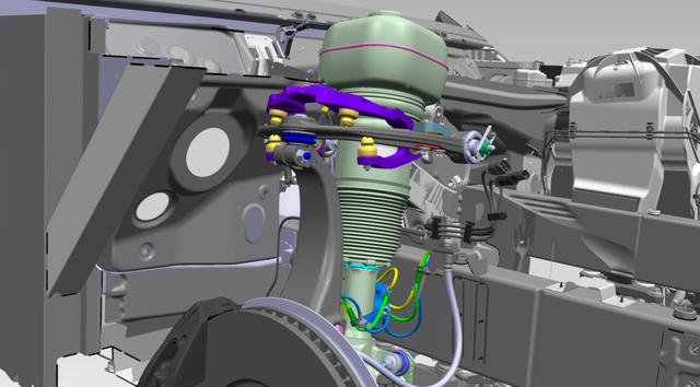 画像: 進化したマジックカーペットライドは、このアッパーウイッシュボーンダンパーで実現している。この開発のためロードテストとベンチテストだけでも5年の歳月がかけられているという。