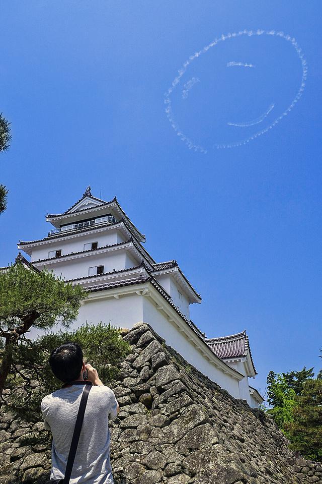 画像: 2020年6月、福島の空に描かれたニコちゃんマーク(PATHFINDER)。