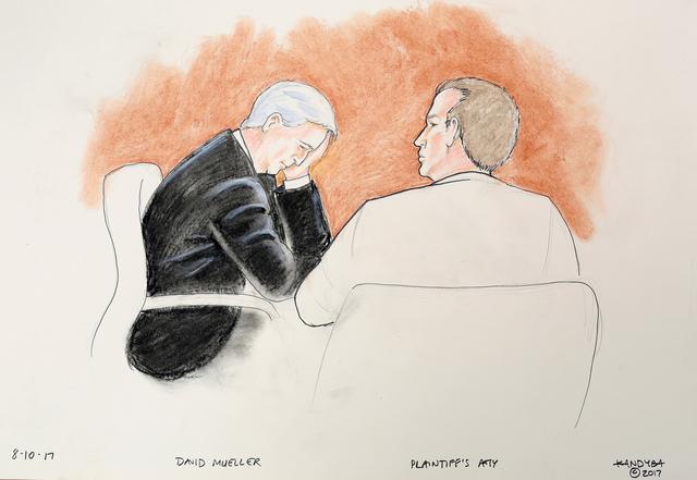 画像: ミューラー氏(左)と弁護人の様子。