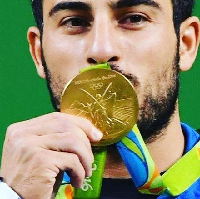 画像2: イラン出身オリンピック選手、祖国地震のために金メダルをオークションに