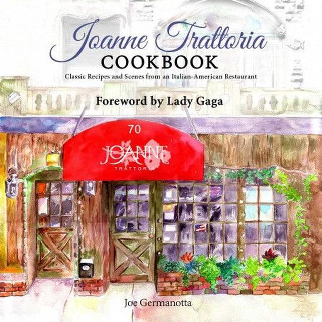 画像: 料理本の表紙にはレストランの外観が描かれている。