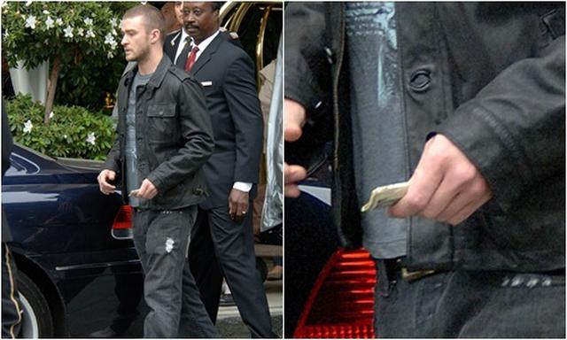 画像: ホテルのスタッフにチップを渡そうとするジャスティンの手には束になったお札が。