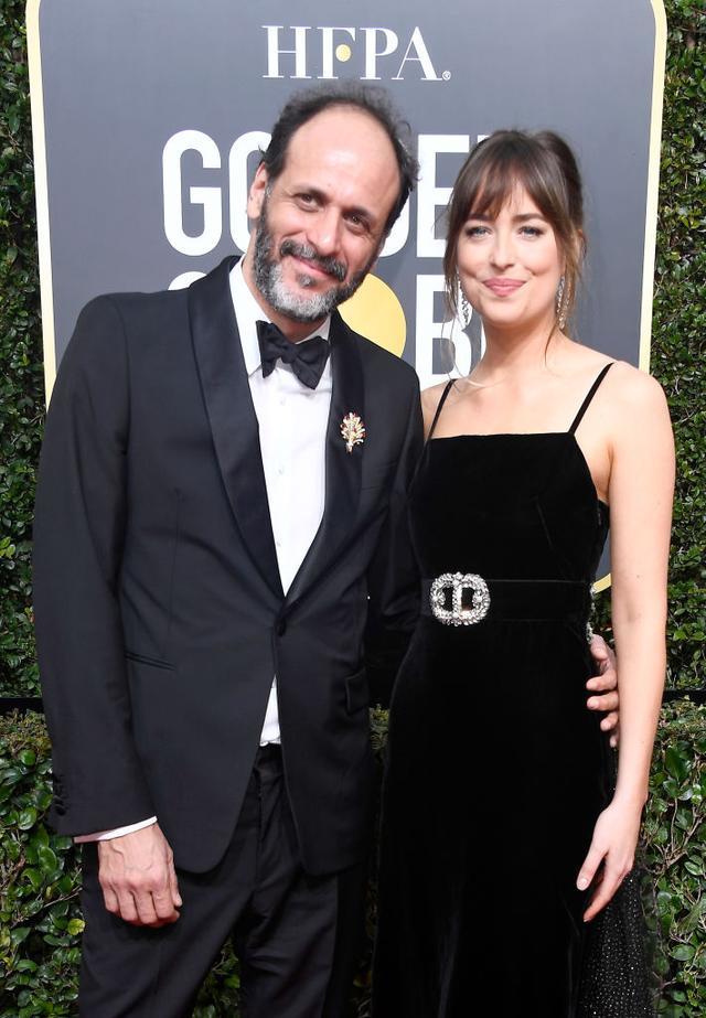 画像: ルカ・グァダニーノ監督と女優のダコタ・ジョンソン。
