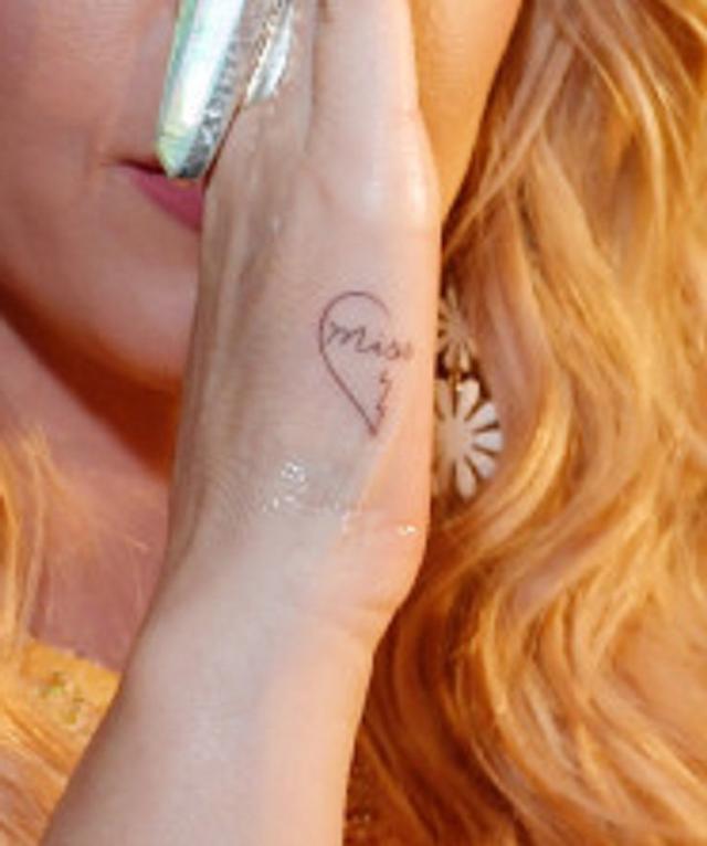 画像2: ケイティ・ペリー、ファンと「おそろいのタトゥー」を刻み絆深める