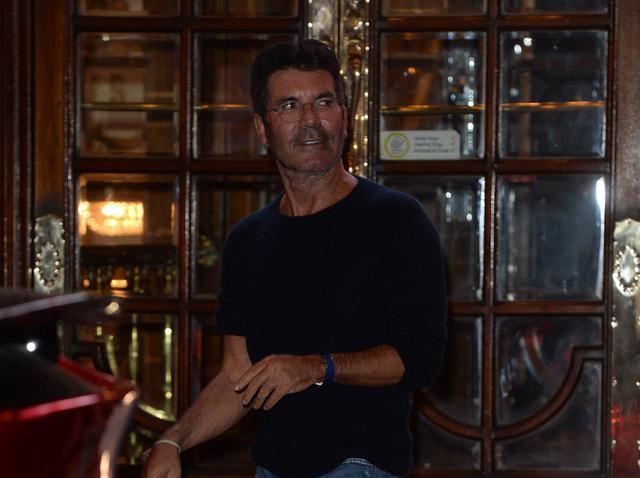 画像: 『ブリテンズ・ゴット・タレント』のロンドンでのオーディション会場を立ち去るサイモン。Pricassoがどの会場でのオーディションに出たかは分かっていない。