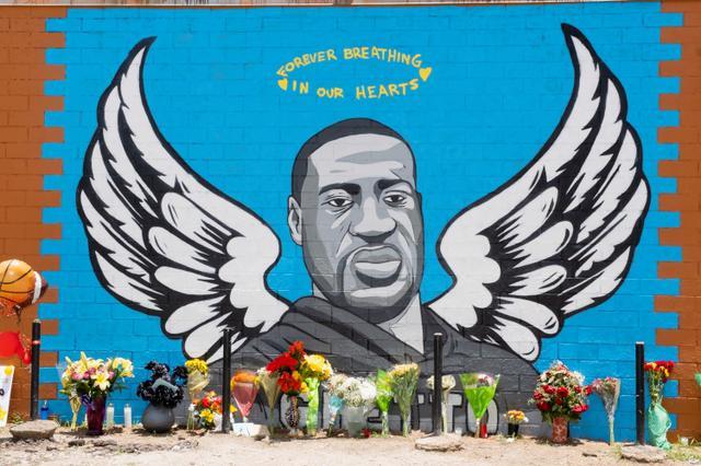 画像: フロイド氏ゆかりの地であるテキサス州ヒューストンのある通りに出現した追悼アート。